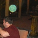 31) The bright green 'Robbie' orb at the barbecue and directly over one of his closest friends.