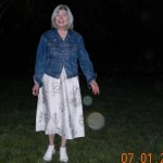 10a) Here's Nancy holding her hand out with two orbs at her fingertips.  Sonny appears in the bigger orb.
