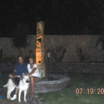 12a) My brother and sister-in-law's photo with two orbs above them, one on each side. The orb to the left was too dark to reproduce, but that is the orb I saw an image that looked like John F. Kennedy